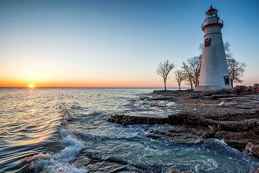 About Our Agency - View Of Lighthouse Along The Coast In The Evening In Amherst Ohio